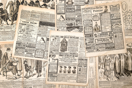 Newspaper pages with antique advertising. Woman Stock Photo