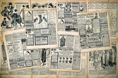 Newspaper pages with antique advertising. Woman 스톡 콘텐츠