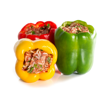 multicolor stuffed bell pepper filled with ground meat, rice, onion and parsley on white  photo