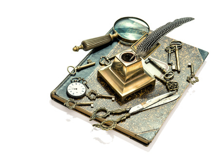 antique keys, pocket watch, ink pen, loupe, book isolated on white . collectibles and vintage goods. retro style toned picture photo