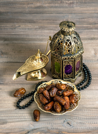Dates, arabian lantern and rosary. Islamic holidays concept. Ramadan decoration Stock Photo