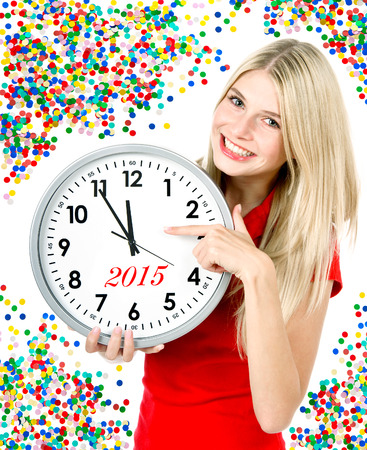 prosit: new year 2015. five to twelve. young beautiful woman with big clock and party decoration Stock Photo