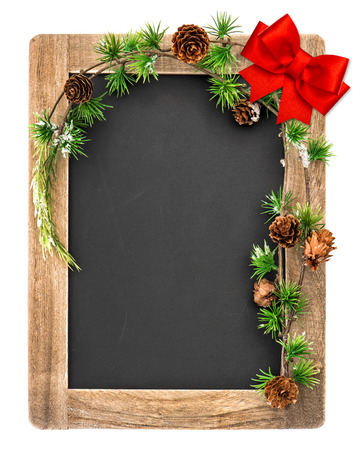 chalkboard with christmas decoration and red ribbon bow. vintage blackboard with place for your text photo