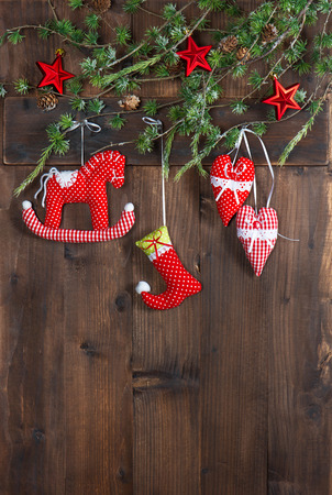 christmas decoration textile handmade toys over rustic wooden background. nostalgic picture with retro style design photo