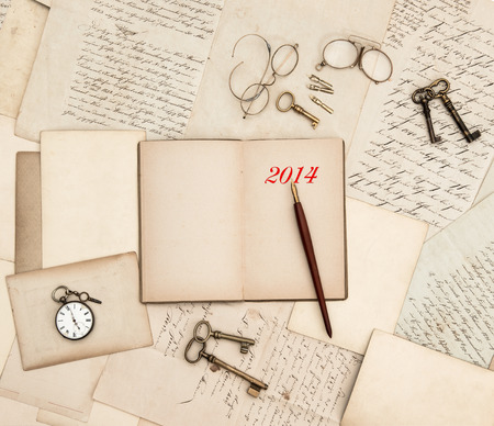 antique accessories, old letters, watch and keys. vintage nostalgic background with diary for 2014 photo