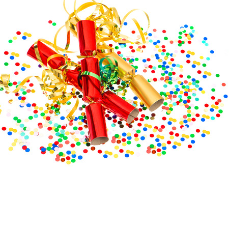 party popper: party cracker, golden streamer and confetti over white. festive decoration background Stock Photo
