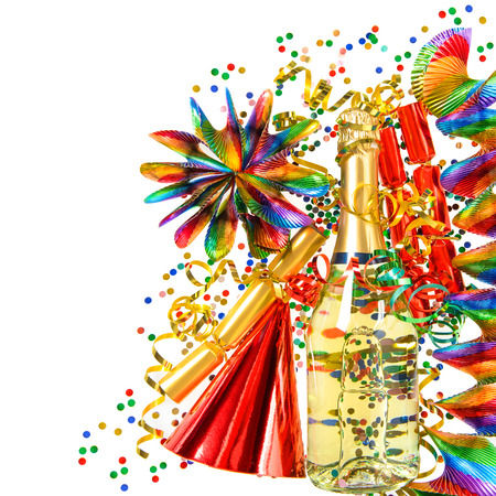 colorful party decoration with garlands, streamer, cracker, confetti and wine bottle. holidays background photo
