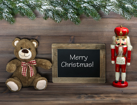 nostalgic christmas decoration with antique toys and blackboard with sample text Merry Christmas! retro style dark picture Stock Photo