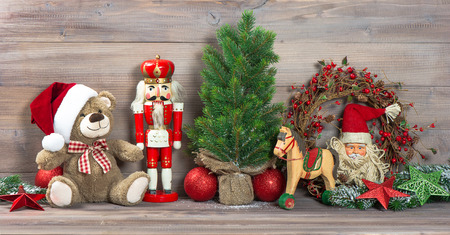 nostalgic christmas decoration with antique toys teddy bear and nutcracker. retro style picture photo