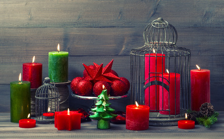 stock photo vintage christmas background with birdcage burning candles and baubles nostalgic home interior decoration retro style toned picture