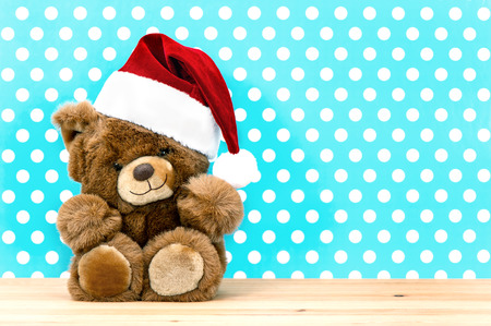 charming vintage teddy bear with santa hat. christmas decoration. retro style picture photo