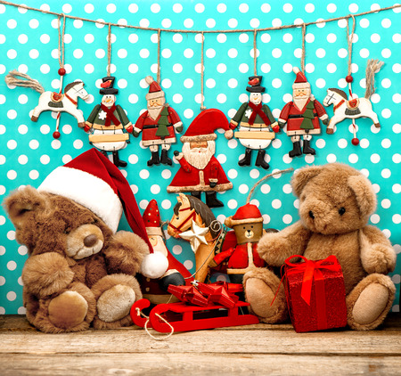 vintage christmas decorations with antique toys and teddy bear. sentimental nostalgic retro style picture Stock Photo
