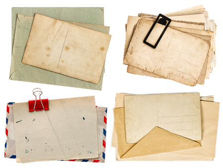 old postcards isolated on white background. vintage paper sheets with clip. air mail envelope. retro design photo