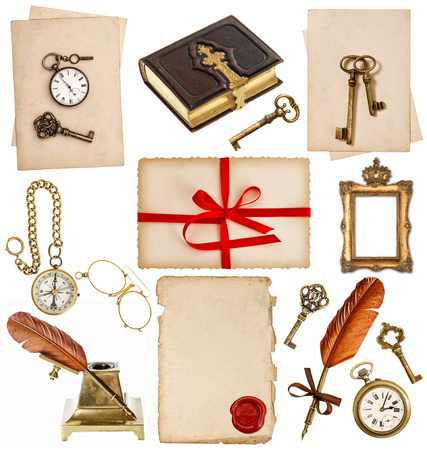 old paper sheets with vintage accessories isolated on white background. antique clock, key, postcard, photo album, feather pen, inkwell, glasses, compass photo