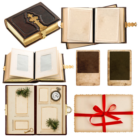 vintage album with retro photo cards. greetings card with red ribbon bow. antique book with golden decoration isolated on white background photo