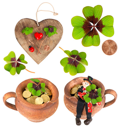wooden heart with symbols of luck. red heart, coin, clover, shamrock, chimney sweep and ladybug. lucky charm photo