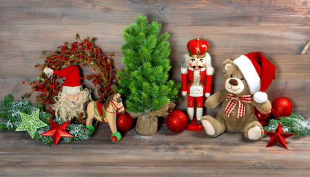 christmas decoration with antique toys teddy bear and nutcracker. retro style toned picture photo