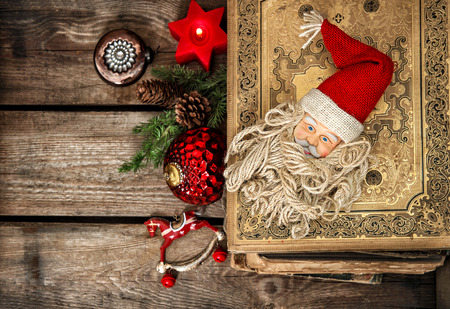 sentimental: vintage christmas decoration with antique baubles and toys on wooden background. sentimental nostalgic retro style picture. dark designed, selective focus