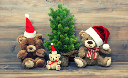 interior decoration accessories: christmas decoration with vintage toys teddy bear family. retro style toned picture Stock Photo