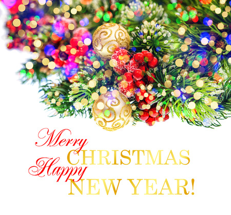 nappy new year: christmas tree branch with colorful lights. festive decoration with sample text Merry Christmas! Happy New Year!