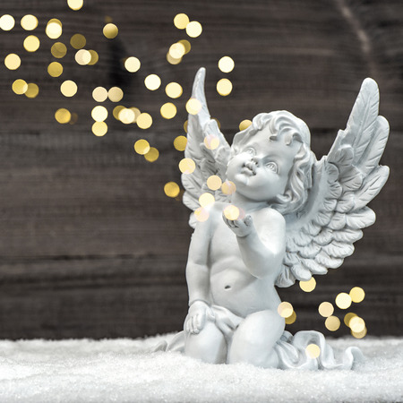 statues: little guardian angel with shiny lights. vintage style christmas decoration