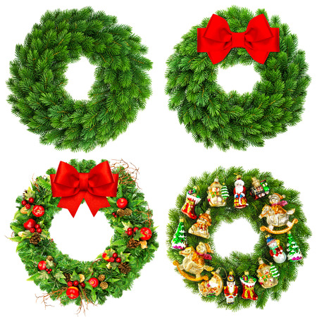 ribbon bow: christmas wreath undecorated and decorated with ornaments, red ribbon bow and vintage toys isolated on white background Stock Photo