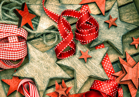 christmas  ornament: christmas decorations wooden stars and red ribbons for gifts wrapping.  Stock Photo