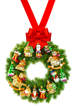 ribbon bow: christmas wreath decorated with ornaments and red ribbon bow isolated on white background
