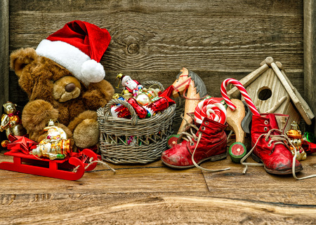 nostalgic christmas decorations with antique toys over wooden background stock photo 34117923 - Nostalgic Christmas Decorations