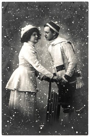 happy young couple outdoors. winter holidays. vintage picture with original film grain and blur Banco de Imagens