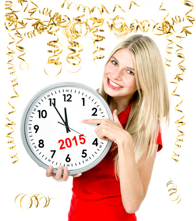 five to twelve: partytime 2015. five to twelve. young beautiful woman with big clock and party decoration Stock Photo