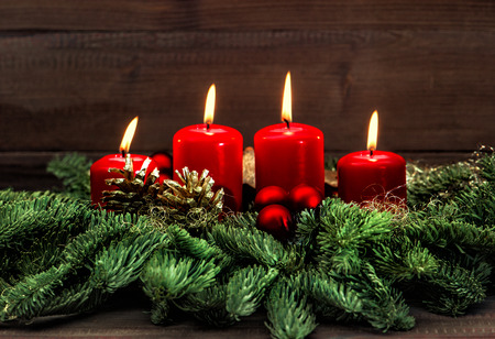 candle: advent decoration with four red burning candles. holidays background.