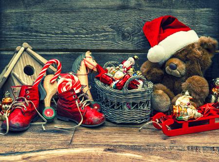 nostalgic christmas decoration with antique toys over wooden background. photo