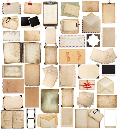 aged paper, books, pages and old postcards isolated on white background.