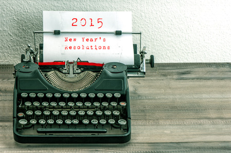 new year: Typewriter with white paper page on wooden table.