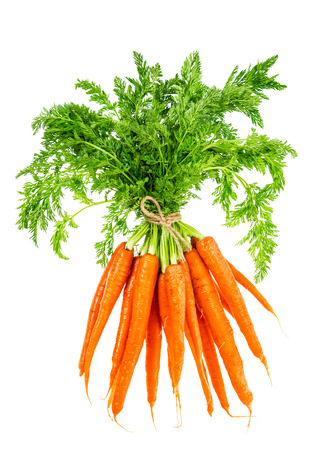 Fresh carrots with green leaves isolated on white background. 写真素材