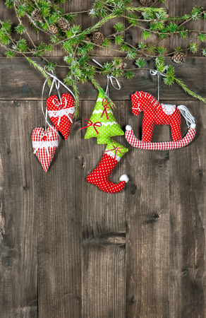 snowflacke: christmas decoration textile handmade toys over rustic wooden background. nostalgic retro style toned picture