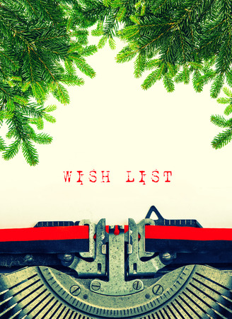 Old typewriter with sample text Wish List. Christmas tree twigs decoration. Retro style toned picture photo
