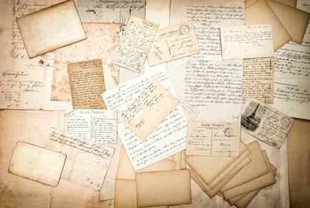 sentimental: old letters, handwriting and vintage postcards. nostalgic sentimental background with vignette