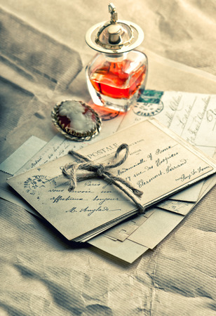 old love letters, antique accessories, perfume and cameo. sentimental nostalgic background. vintage style toned picture Stock Photo