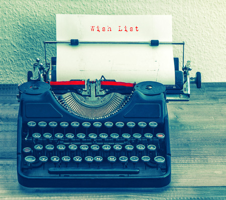 Old typewriter with sample text Wish List. Retro style toned picture photo