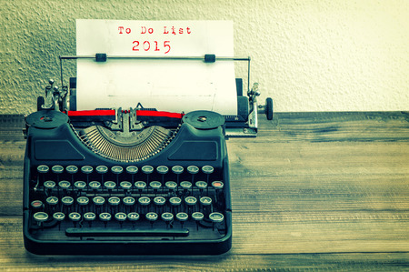 Typewriter with white paper page on wooden table. sample text To Do List 2015 vintage style toned picture photo