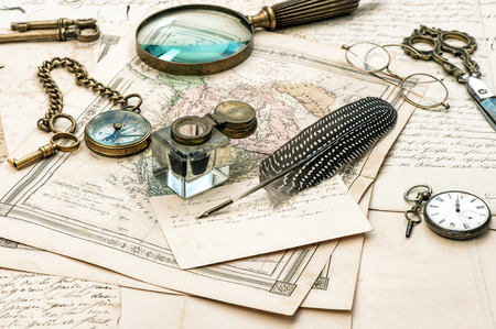 ephemera: old letters and maps, vintage ink pen. ephemera and antique accessories. retro style toned picture