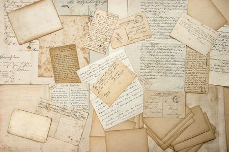 vintage travel: old letters, handwriting, vintage postcards, ephemera. grungy nostalgic sentimental paper background