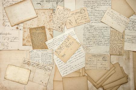 oude brieven, handschrift, vintage ansichtkaarten, efemere. grungy nostalgische sentimentele papier achtergrond