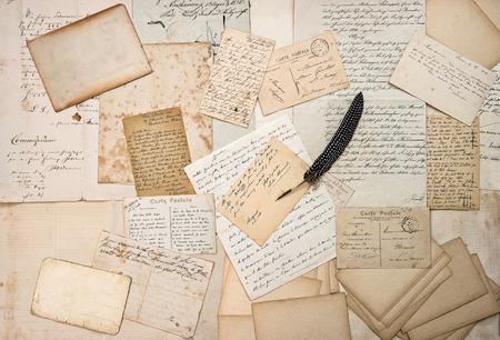 nostalgic: old letters, handwriting, ephemera, vintage postcards and antique feather pen. nostalgic sentimental aged paper background