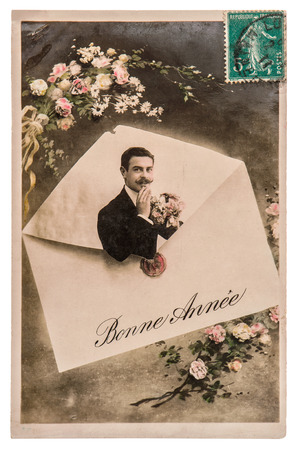 bonne: portrait of young man with rose flowers. sample text Bonne Anne Happy New Year. antique french greetings card Stock Photo