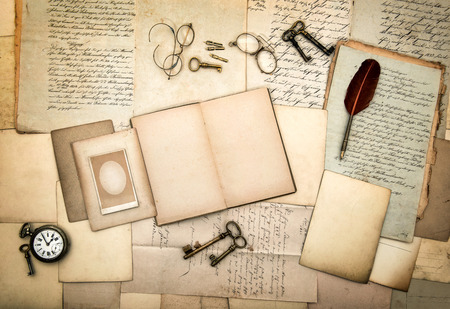 open diary: open diary book, old letters, picture frames, vintage accessories and office supplies. nostalgic background