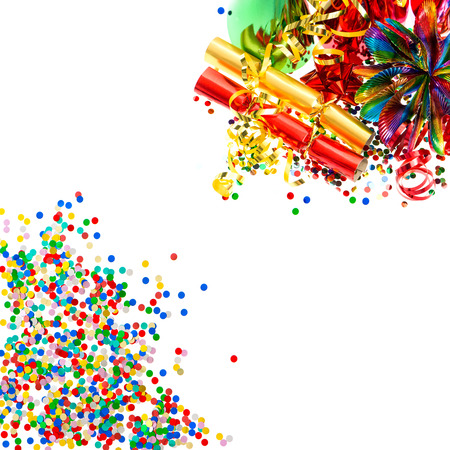 fiesta: colorful garlands, streamer, cracker, party hats and confetti. festive decoration background