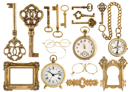 golden antique accessories. baroque frame, vintage keys, clock, compass, retro glasses, pocket watch isolated on white background photo